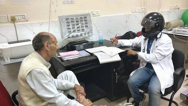AIIMS doctors wearing helmets